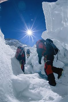 The constantly shifting Khumbu Icefall is like a bunch of ice cubes continually tumbling down the icy mountain wall.