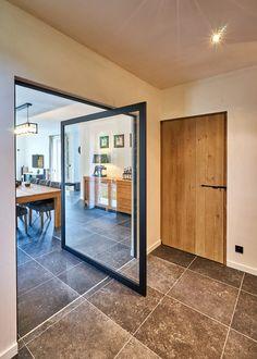Steel look pivot door with glass and offset axis pivoting hinges. Pivot Doors, Sliding Doors, Garage Doors, Glass Shower Doors, Glass Doors, Design Awards, Ideal Home, Aluminium, Plank