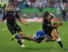 Paul Jordaan of The Sharks tries to get pass Damian de Allende of the Stormers during the Super Rugby match between DHL Stormers and The Sharks at DHL Newlands on April 2013 in Cape Town, South Africa. Rugby Sport, Super Rugby, Shark Bites, April 13, Latest Pics, Sharks, Cape Town, South Africa, Running