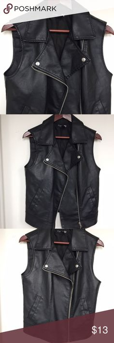 Forever 21 Faux-Leather Vest Forever 21 Faux-Leather Vest. Black with silver hardware detailing. Still in good condition. Perfect to dress up or style down. Forever 21 Jackets & Coats Vests