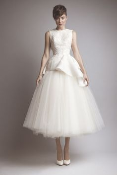 I adore this dress. I plan on wearing a tea length wedding dress and white kitten heels when I get married.