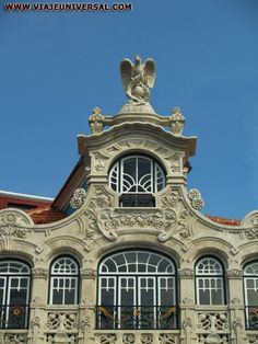 ART NOUVEAU EN AVEIRO, PORTUGAL  This building was abandoned when I saw it last.  I'm so happy it's back in order.  R.