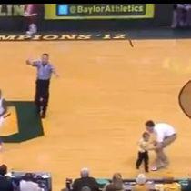 WATCH: Small kid runs onto basketball court during Baylor Oklahoma game   hahaha so cute!