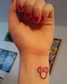 This sweet mini Minnie Mouse tattoo is proof that sometimes less is more.