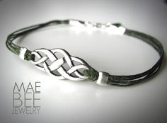 Sterling Celtic Knot on green linen #bracelet from JewelryByMaeBee on #Etsy.