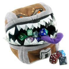 Mimics pretend to be treasure chests as it's a sure fire way to catch adventurers out. In other words; Mimics are synonymous with  precious items but and risk. Isn't that exactly what dice bags are all about?