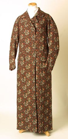 Manchester City Galleries, Item 1976.88  Dressing gown 1790-1810  Dark brown twilled cotton dressing or morning gown printed with pattern of trailing flowers in red-brown, cream, white and light blue, lined white twilled cotton.