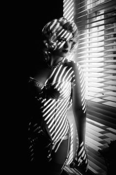 In this Photoshop tutorial, you'll learn how to make photo a look like it was shot in the 1940s or 1950s in a film noir style.