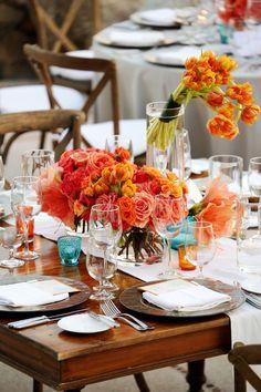 Modern coral and orange centerpieces, floral design by Elena Damy, photo by Chris + Lynn Photographers | via junebugweddings.com