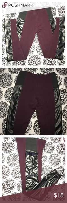 New leggings with faux leather accent These NEW leggings really hug the legs and are very flattering. Rich burgundy wine color, black elastic band at hips and faux leather accent down legs. had to buy a large so these were an extra pair since I had already taken the tag off. *nylon, polyester, spandex * Pants Leggings