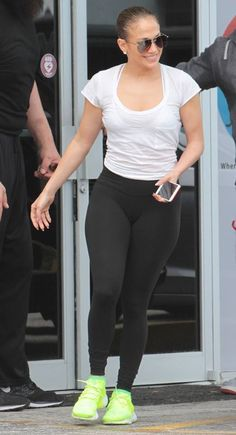 Jennifer Lopez wearing Nike sneakers & Quay sunglasses as she leaves a gym in Miami. #JLO #workoutstyle