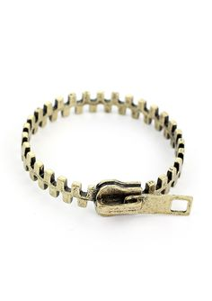 -100% Metal  -Avoid contact with liquids  -This bracelet has ben crafted in a retro metal base in a unqiue zip shape.    Measurement: Diameter               7cm/2.7inches