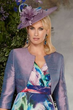 11286 (Condici) A small saucer style fascinator in Lilac Shimmer & Pizzazz. The fascinator is placed on an alice band and is worn slightly to one side. To the top of the fascinator you have pretty floral & feather detailing Read More...