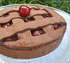 Questa crostata è libidine pura! Il guscio amarognolo di pasta frolla al cacao racchiude una morbida crema al cioccolato e una cascata ...