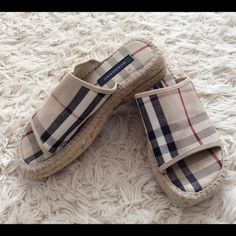 Authentic Burberry Kids Espadrilles Slip On Shoes Authentic Burberry Kids summer espadrilles in excellent condition except for stain on the sole as you can see in the picture.  Very hard to find!! Burberry Shoes