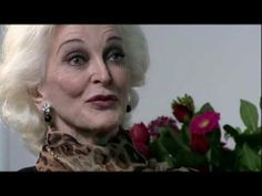 This is Carmen Dell'Orefice. She is a gorgeous active model of 81 years old.  She has been modeling since she was 15. This is a one hour and 20 min. interview.  When you have the time every woman should watch this.  Elegance, grace, wisdom.  A woman of great class.  Her life has been very interesting.  I loved this interview and loved listening to this lady.