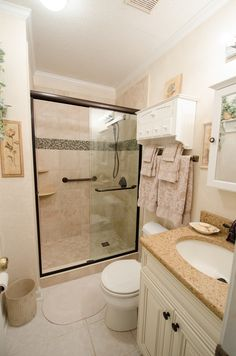 Bathroom Remodel brought to you by Re-Bath of the Triangle, Glass, walk-in shower, dual grab bar, corner shelves, tile feature strip, low threshold walk in shower, perfect for Universal Design bathrooms, Aging in Place Showers. New vanity, new flooring.