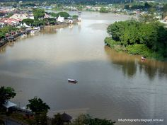 The Sarawak River seen from the 14th floor of the Riverside Majestic Hotel in Kuching, Malaysia in January 2012