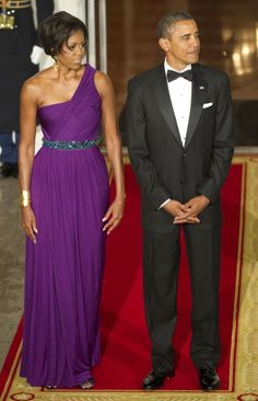 US President Barack Obama and First Lady Michelle wait for South Korean President Lee Myung-bak and First Lady Kim Yoon-ok at the North Portico of the White House in Washington, DC, October 13, 2011.Photo Credit: JIM WATSON, AFP, Getty Images via StyleList
