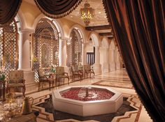 A warm welcome of Arabic coffee and delights at the lobby majlis at The Ritz Carlton Dubai.