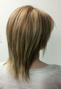 Lightening medium brown hair to blonde. Full highlight and long layer cut Created by Geneva Rygel