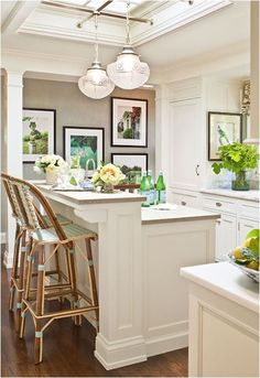 counter height kitchen island to hide the mess. bar height open plan is only for a model home where the kitchen is never used.