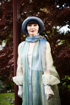 Miss Fisher, pictured in the episode entitled Death Defying Feats. The material for this coat was purchased in Italy and lined with a very fine green and gold net to create a ripple effect.