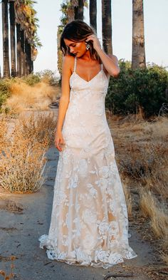 """The """"Sonje"""" floral print wedding dress is for our free-spirited bohemian bride. This intricate slip dress is designed in an ivory tulle with a velvet"""