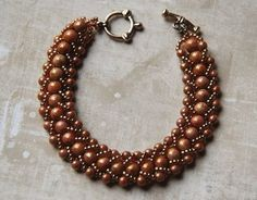 I really love her flat spiral bracelet - her choice of brown toned beads is truly inspired!