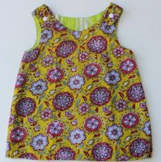 Reversible Dress Sewing Tutorial maybe this would be good for the girls? Except not reversible, just in the ruffle fabric and have an ivory tulle sash. looks pretty easy Kids Dress Patterns, Jumper Patterns, Sewing Patterns Free, Free Sewing, Clothing Patterns, Free Pattern, Sewing Kids Clothes, Sewing For Kids, Dress Sewing Tutorials