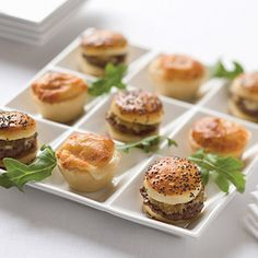 A classic appetizer all dressed up, these mini burgers feature 100% luxurious, Kobe beef.  Thick and juicy, they will satisfy any crowd, gourmet or not.  In two bold flavors: Carmelized Onion with Gorgonzola and Bacon and Cheddar.  Black tie optional.  18 sliders.