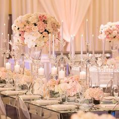 Loving this centerpieces in whites and blush tones @butterflyfloral photo: @dukeimages coordinator: @delicatedetails #beautifulflowers #weddingdecor #weddingcenterpieces #weddingphotographer #flowers #centerpieces #candles #design