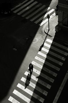 A fantastic street photo. The lights and shadow and lines are just perfectly composed.