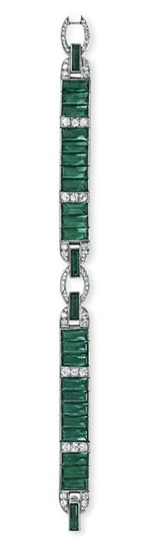 "AN ART DECO GREEN TOURMALINE & DIAMOND BRACELET, by CARTIER   Designed as a rectangular-cut green tourmaline band, joined by old European & single-cut diamond geometric links, mounted in platinum, ca 1925, 7-1/8"".  Signed Cartier."