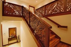 Tropical leaf pattern carved mahogany staircase balustrade...