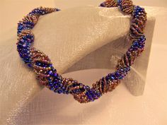 Peacock Swirl -  spiral necklace, blue iris and gold beads with metallic tones,romantic gift, occasion, gift for her, statement