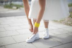 A Bride in Converse, a polka dot 50's wedding dress & vintage yellow beads...