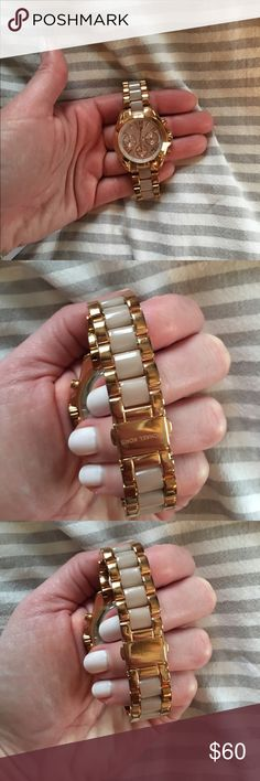 Michael Kors Rose Gold Bradshaw Watch Great watch, wore daily for a few months.  Metal has some oxidation making it look more gold than rose.  Still in great shape and would look like new with a good cleaning.  Comes with box, booklet thing and extra links.  Can answer any questions if needed. Michael Kors Accessories Watches