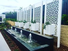 Our Cog pattern feature screens with integrated planters - all aluminium - standing proud in this new @homesmasterton display. @poboxdesigns #custommade #lasercut #designer #featurescreen