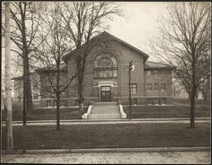 Women's Gymnasium, view from across Park Place. It opened in 1909 and originally served both men and women. In 1923 it became the women's gym once a new men's gymnasium (Bentley) opened. The Women's Gym was demolished in 1966 to make room for Alden Library. :: Ohio University Archives