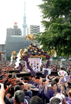 "A record crowd of 1.87 million turned out for this year's annual Sanja Matsuri festival, which culminated on May 19 with a parade of main portable shrines through Tokyo's Asakusa district. The centuries-old festival at Asakusajinja shrine enjoyed mostly fine spring weather over the three-day period. On the final day, three ""mikoshi"" portable shrines from the main shrine proceeded through the neighborhood, carried by participants in traditional dress."