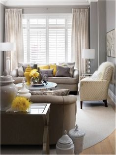 Grey Living room with a pop of color ... looking for ways to lighten it up