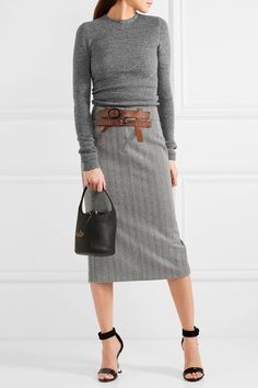 TOM FORD Herringbone wool and cashmere-blend tweed skirt $1,950  We first spotted TOM FORD's skirt on the September runway - it became available to shop instantly after the show. Made in Italy from monochrome herringbone wool and cashmere-blend tweed, it's contrasted with optional tan leather buckles and a lace-up back. Showcase the fitted waist with a tucked-in sweater.   Shown here with: TOM FORD Sweater, TOM FORD Bucket bag, TOM FORD Sandals, Repossi Ring, Repossi Ring.