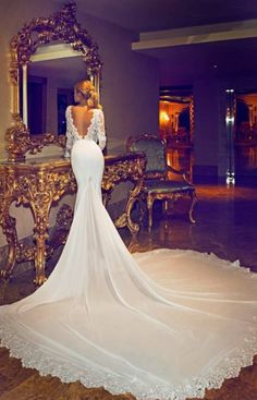 Train is a little long but the dress is breath-taking. Open-back and form-fitting