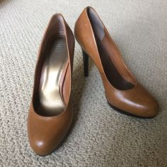 INC International Concepts pumps Tan pumps with wooden platform and heel. Leather upper. Some light scratches on leather but mostly came that way when I bought them. A go-to pump that goes with everything! INC International Concepts Shoes Heels