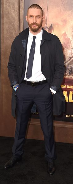 British actor Tom Hardy wearing a navy Burberry trench coat to the premiere of Mad Max: Fury Road in Los Angeles