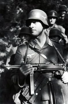 Members of a Luftwaffe field division are following their officer during the German summer offensive on the eastern front in 1942. From early 1942 onward, the German army was strengthened by airforce and naval personnel. The brand new equipment and the 'innocent' look of these men indicate they have not taken part in actual fighting yet. No doubt, this would soon change. The MP40 submachine gun is of the second production type. Russia, Spring or Summer 1942.
