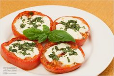This hot version of a Caprese salad is made with sliced tomatoes, garlic, olive oil, fresh mozzarella and chopped basil.