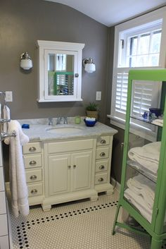 After: vanity and towel cabinet