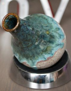 gun metal green over oasis blue with oatmeal on the bottom, coyote glaze